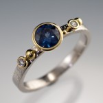 18kw/y gold ring, set with fair trade Malawi sapphire, approx 0.60ct, and 0.04ct T.W. Harmony recycled diamonds from Hoover & Strong. Photo courtesy Nodeform.