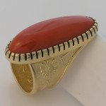 A perfect piece of red coral is all that is needed in this 18k yellow gold ring. Photo courtesy of the artist, Darryl Dean Begay.