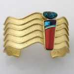 18k yellow gold bracelet with turquoise and lapis. Native American jewelry artist Darryl Dean Begay draws on his culture's tradition of setting coral with turquoise, but with a contemporary twist. Photo courtesy of the artist, Darryl Dean Begay.